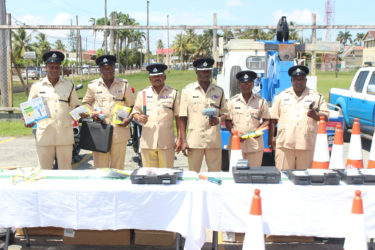 Traffic Chief Deon Moore (third from right) and other senior police officers from the Traffic department displaying the equipment.