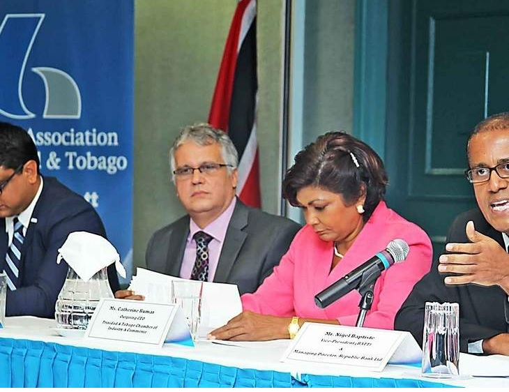 Bankers Association vice-president Nigel Baptiste, right, makes a point during a news conference on the Foreign Account Tax Compliance Act legislation at Republic Bank, Park Street, Port of Spain, yesterday. Accompanying him, from left, are chief executive of the American Chamber, Nirad Tewarie; president, Association of Trinidad and Tobago Insurance Companies, James Camacho; and CEO of the Trinidad and Tobago Chamber of Commerce, Catherine Kumar.