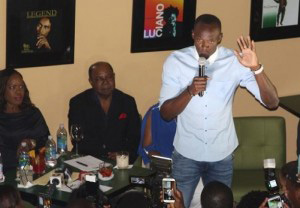 Usain Bolt speaking at the opening of the Ocho Rios franchise. (Picture courtesy loop)