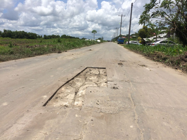 One of the larger holes that were cut in preparation for the road repairs.