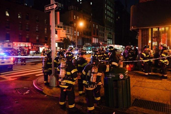 New York City firefighters stand near the site of an explosion in the Chelsea neighborhood of Manhattan, New York, U.S. September 17, 2016. REUTERS/Rashid Umar Abbasi