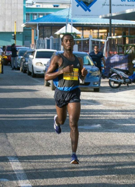 Cleveland 'Little Kenyan' Forde crossing the finish line all alone to take the top honors of the Courts 10K Run yesterday.