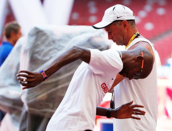 FLASHBACK! Mo Farah of Great Britain jobs past coach Alberto Salazar in the Bird's Nest Stadium at the Wold Athletics Championships in Beijing, China. (REUTERS/Lucy Nicholson/Files)