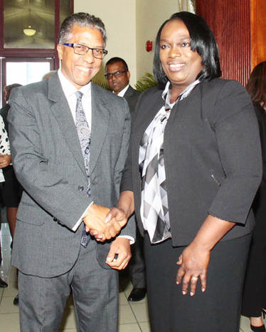 President of the Law Association Reginald Armour, left, greets Industrial Court president Deborah Thomas-Felix during the opening of the Industrial Court