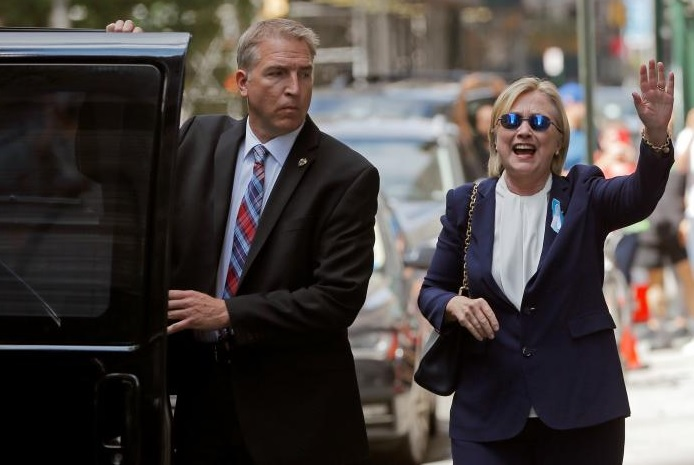 U.S. Democratic presidential candidate Hillary Clinton leaves her daughter Chelsea's home in New York, New York, United States September 11, 2016, after Clinton left ceremonies commemorating the 15th anniversary of the September 11 attacks feeling 'overheated.' REUTERS/Brian Snyder