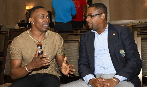 Dave Cameron (right) with Dwayne Bravo at a recent forum.