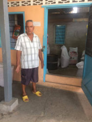 Neville Sooklall standing next to the shop where his daughter-in-law was stuck up by one of the bandits.