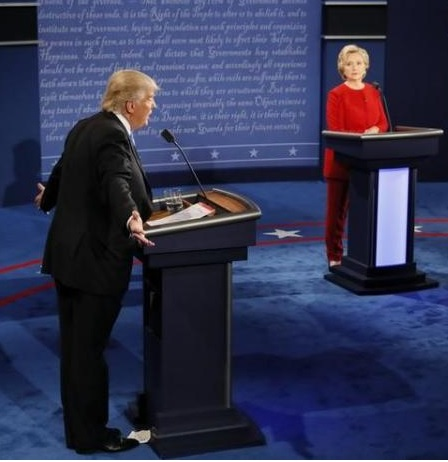 Republican U.S. presidential nominee Donald Trump speaks as Democratic U.S. presidential nominee Hillary Clinton listens during their first presidential debate at Hofstra University in Hempstead, New York, U.S., September 26, 2016. REUTERS/Rick Wilking