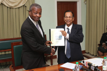 Auditor General Deodat Sharma (right) presents Speaker of the National Assembly Dr Barton Scotland with the 2015 Auditor's General's Report. (Photo by Keno George)