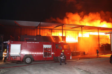 Firefighters on the scene at the Gafoor's Houston Complex as the fire raged in Bond 6 last evening