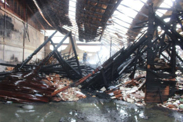 The collapsed interior of the bond which was ravaged in Monday evening's fire at the Gafoors Houston Complex.