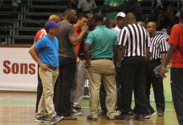 Power Meeting-Director of Sports Christopher (3rd from left) Jones in discussions with members of the Suriname and Guyana Management teams as well as the officials following the discovery of the broken backboard caused by a dunk from Suriname's Xavier Nassy at the Cliff Anderson Sports Hall