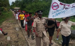 Region 3 Police Commander, Leslie James leading the march (NADF photo)