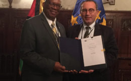 Stefano Manservisi (right), Director General for International Cooperation and Development of the European Commission with Minister of Finance Winston Jordan.