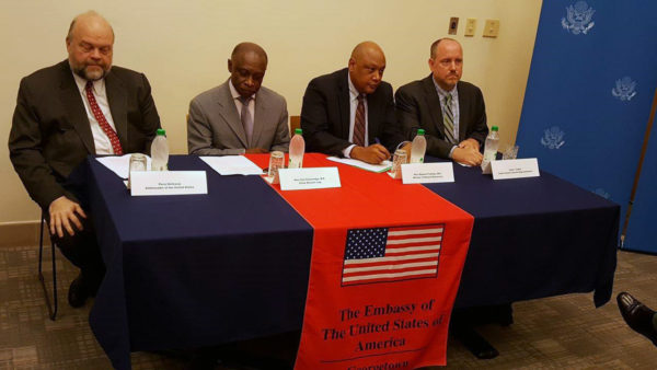 From left to right are United States Ambassador Perry Holloway, acting Prime Minister Carl Greenidge, Minister of Natural Resources Raphael Trotman and Carter Center Representative Jason Calder.