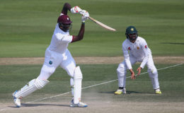 Captain Jason Holder drives  attractively during his unbeaten knock of 31 yesterday. (Photo courtesy of WICB media)