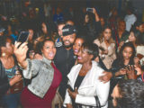 Fans take photos with T&T soca star Machel Montano after he arrived at the Scotiabank Theatre in Canada, where he joined fans for a showing of Bazodee on Tuesday night. Montano was the headline act at the We Day Benefit concert on Wednesday night.