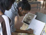 Nicole Bissoo-Williams at work with one of her students at the Burrowes School of Art.