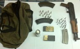 The AK 47 and ammo found (Police photo)