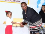 Glenna Vyphuis, Chief School's Welfare Officer making a presentation to one of the children. (Ministry of Education photo)