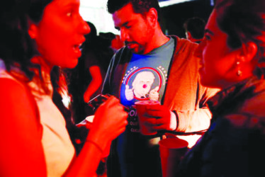 A reveler wearing a t-shirt with an image of Republican presidential nominee Donald Trump attends a Mexican brewery booze-up in Mexico City, Mexico October 20, 2016. REUTERS/Carlos Jasso
