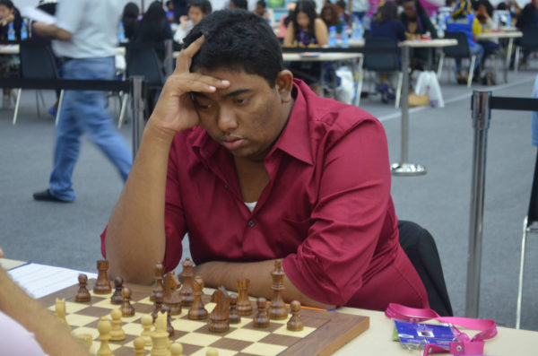 Taffin Khan contesting one of his games for Guyana at the 42nd Chess Olympiad in Baku, Azerbaijan. Khan was the most successful player for the men's chess team at the Olympiad. He contested ten games, at times playing Board One for his country, and scored victories against Guernsey, Malta, Bermuda and Macau. He drew with Fiji, Guatemala, San Marino and Lesotho and lost to Macedonia and Ghana. Khan's six points was the highest score from the men's team.