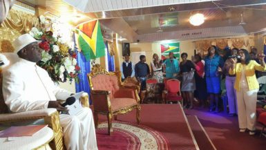 Bishop Philbert London (left) and members of his congregation yesterday