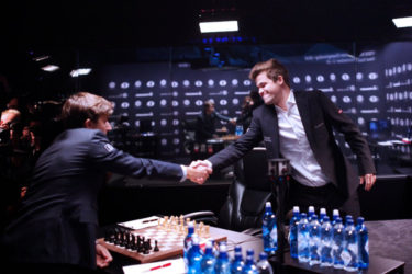 Sergey Karjakin, the challenger (left) shakes the hand of Magnus Carlsen, the defending world champion, before the start of yesterday's fifth game of their World Chess Championship title match, in Manhattan, New York. (Photo courtesy of FIDE.com) (See page 29)