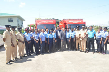 Minister of Public Security, Khemraj Ramjattan and Minister of Public Health, Dr. George Norton (centre) along with members of the Guyana Fire Service, and Emergency Medical Technicians (GINA photo)