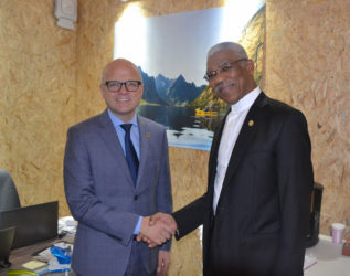President David Granger (right) and Minister of Climate and Environment,  Vidar Helgesen of the Kingdom of Norway following their meeting on Wednesday. (Ministry of the Presidency photo)