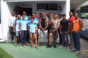 Some of the local and visiting athletes of the 'Stage of Champions' pose for a photo yesterday following the athletes meeting at Olympic House.