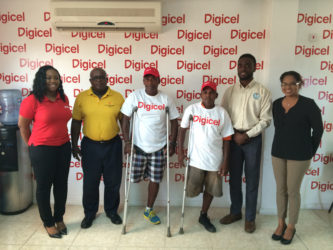Digicel's Senior Sponsorship & Events Executive, Louanna Abrams (left) pose for a photo with head of the Special Olympics committee Wilton Spenser, some of the athletes for the event and Assistant Director of Sports Bryan Smith. To the extreme right is Digicel's Communications Manager, Vidya Bijlall-Sanichara.