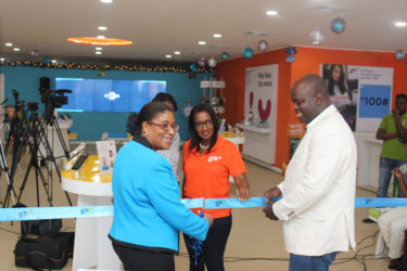 Minister of Public Telecommunications, Cathy Hughes (left) and CEO of GTT Justin Nedd (right) during the ceremonial cutting of the ribbon to launch the new GTT Customer Experience store on Brickdam.