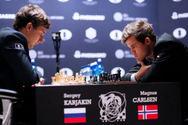 Serjey Karjakin and Magnus Carlsen in deep concentration during yesterday's game six encounter. (Photo courtesy Fide website)