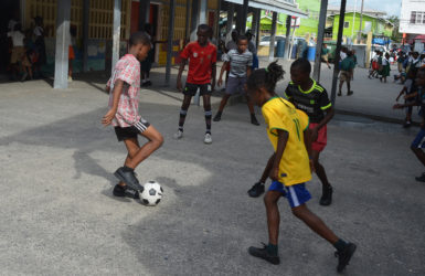 Captain of St. Angela's Antonio McArthur (left) initiating an attacking pattern alongside Seon Cato (right) during the final practice session before their clash with neighbors St. Agnes in the Courts Pee Wee Football finals.