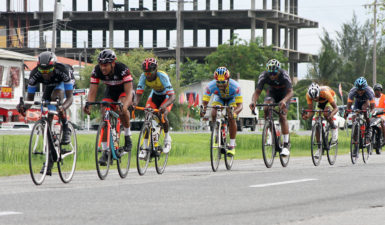 The peloton going full throttle in yesterday's feature 20-lap race of the Team Alanis cycling programme. (Orlando Charles photo)