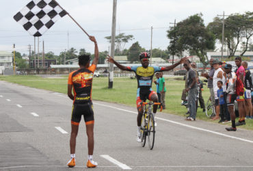 Soloist! Shaquel Agard completed back-to-back wins yesterday after a breakaway from the remnants of the peloton at the bell lap. (Orlando Charles photo)