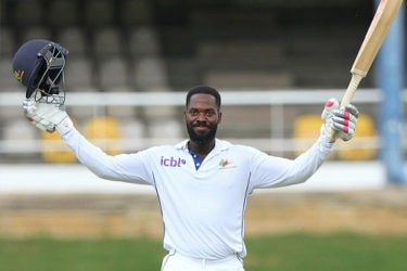 Opener Anthony Alleyne celebrates reaching his maiden first class century against T&T Red Force at Queen's Park Oval yesterday. (Photo courtesy WICB Media)