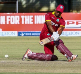 Evin Lewis sweeps during his innings of 148 (photo courtesy of WICB media)