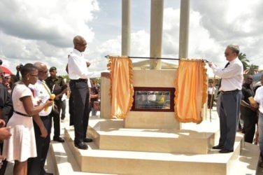 President David Granger and Chinese Ambassador Zhang Limin unveiling the plaque to officially commission the Centennial Arch, which is located at the intersection of Washerpond Road and Causarina Drive in Mackenzie, Linden. (Ministry of the Presidency photo)