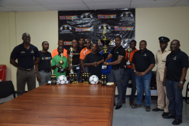 Representatives from participating teams at the launch of the 7th edition of the Guinness Greatest in the Streets football tournament yesterday, along with Lee Baptiste, Guinness brand manager (extreme left), Carena Damon of Colours Boutique (5th from left), Mark Carrega , Up Like 7 team member, shaking hands with Ian Charles , Guinness Rep.(centre), Troy Mendonca, Petra (3rd from right), and Troy Peters, Banks DIH Communications Officer,(extreme right).