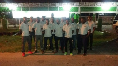 Jamaica bound-The Guyana Senior Basketball Team pose for a photo opportunity in front of the Cliff Anderson Sports Hall prior to their departure for Jamaica to compete in Tri-Nation Invitational Series