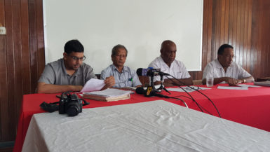 From left are Aslim Singh and Komal Chand, of GAWU, NAACIE General Secretary Kenneth Joseph and GAWU General Secretary Seepaul Narine
