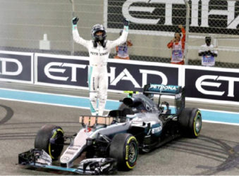 Mercedes' Formula One driver Nico Rosberg of Germany celebrates after winning the Formula One world championship. REUTERS/Ahmed Jadallah