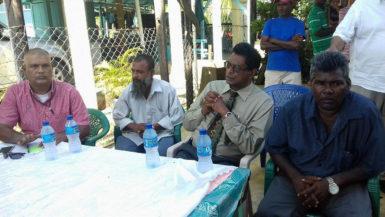 From left are the Prime Minister's Representative in Region Six, Gobin Harbhajan; Faiyaz Narinedatt's uncle, Abdul Shafeek; Public Security Minister, Khemraj Ramjattan and the father of Faiyaz Narinedatt.