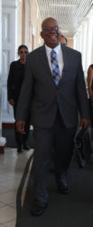 Finance Minister Winston Jordan arrives at the Public Buildings for yesterday's budget presentation. (Photo by Keno George)