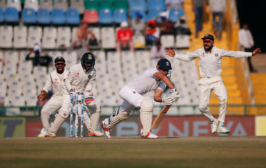 England's captain Alastair Cook (2-R) is bowled by Ravichandran Ashwin (REUTERS/Adnan Abidi)