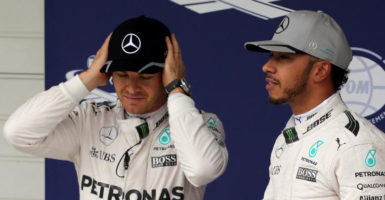 Mercedes' Lewis Hamilton of Britain (R) stands next to Mercedes' Nico Rosberg of Germany at the Brazilian Grand Prix. (REUTERS/Paulo Whitaker)