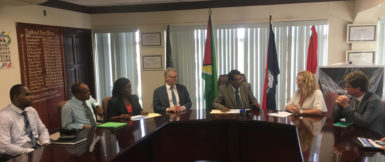 Minister of Public Security Khemraj Ramjattan (third, right) engages Coordinator of SEACOP Karen Clarke (second, right). Looking on are High Commissioner of the United Kingdom to Guyana Greg Quinn (right), EU Ambassador Jernej Videtic (fourth, left), Crime Chief Wendell Blanhum (left) and others.