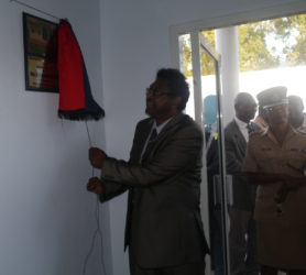 Minister of Public Security, Khemraj Ramjattan unveiling the plaque at the official opening of the Seelall Persaud Fitness Centre yesterday.